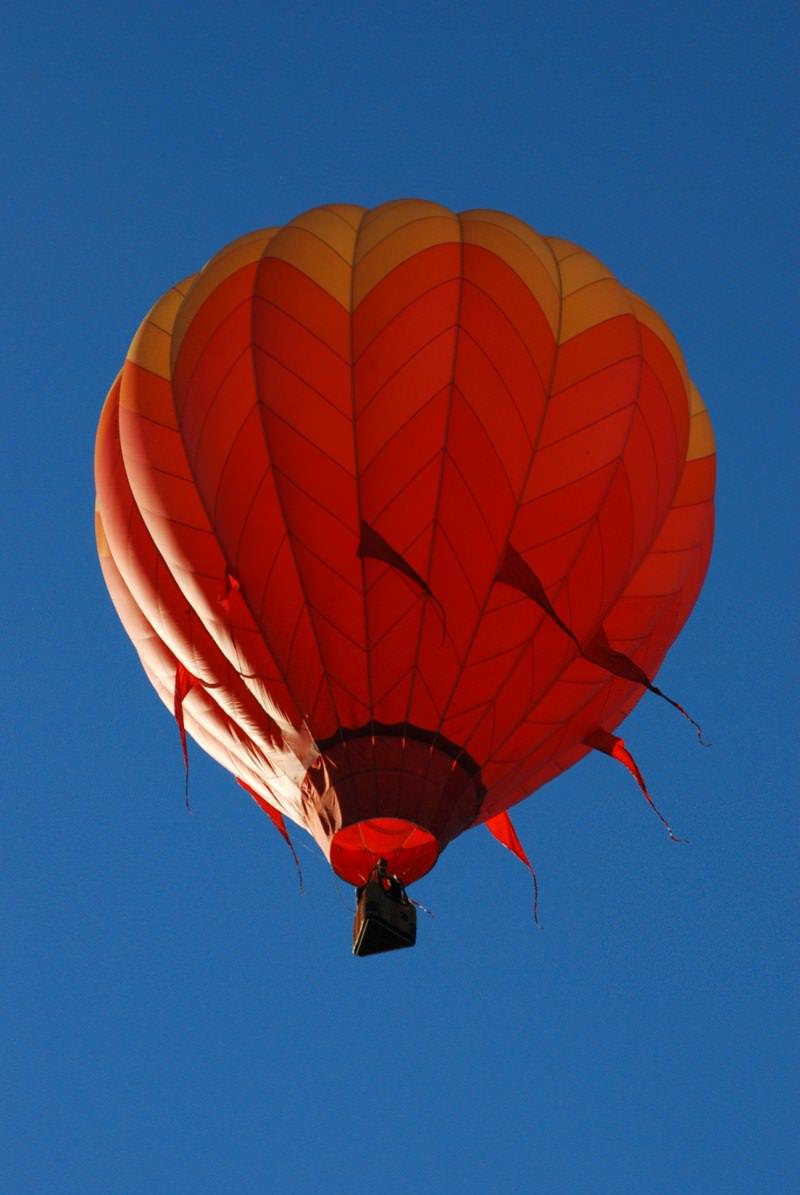 Orange Balloon passing overhead