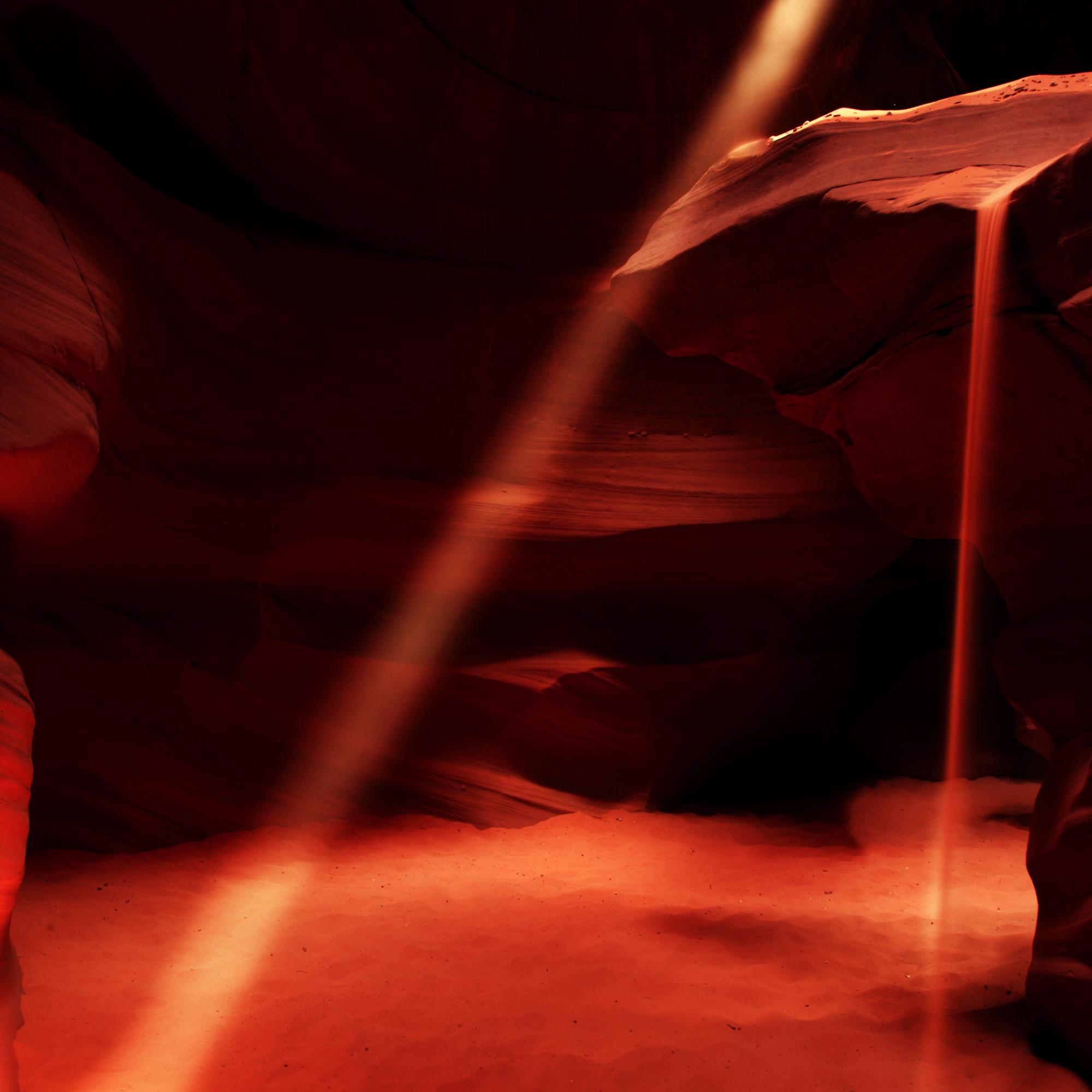 Light Beams and Flowing Sand in the Slot Canyons