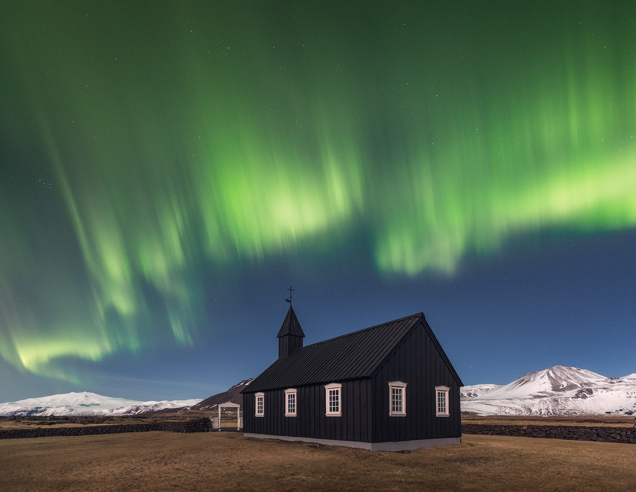 Northern Lights over the Black Church of Budir