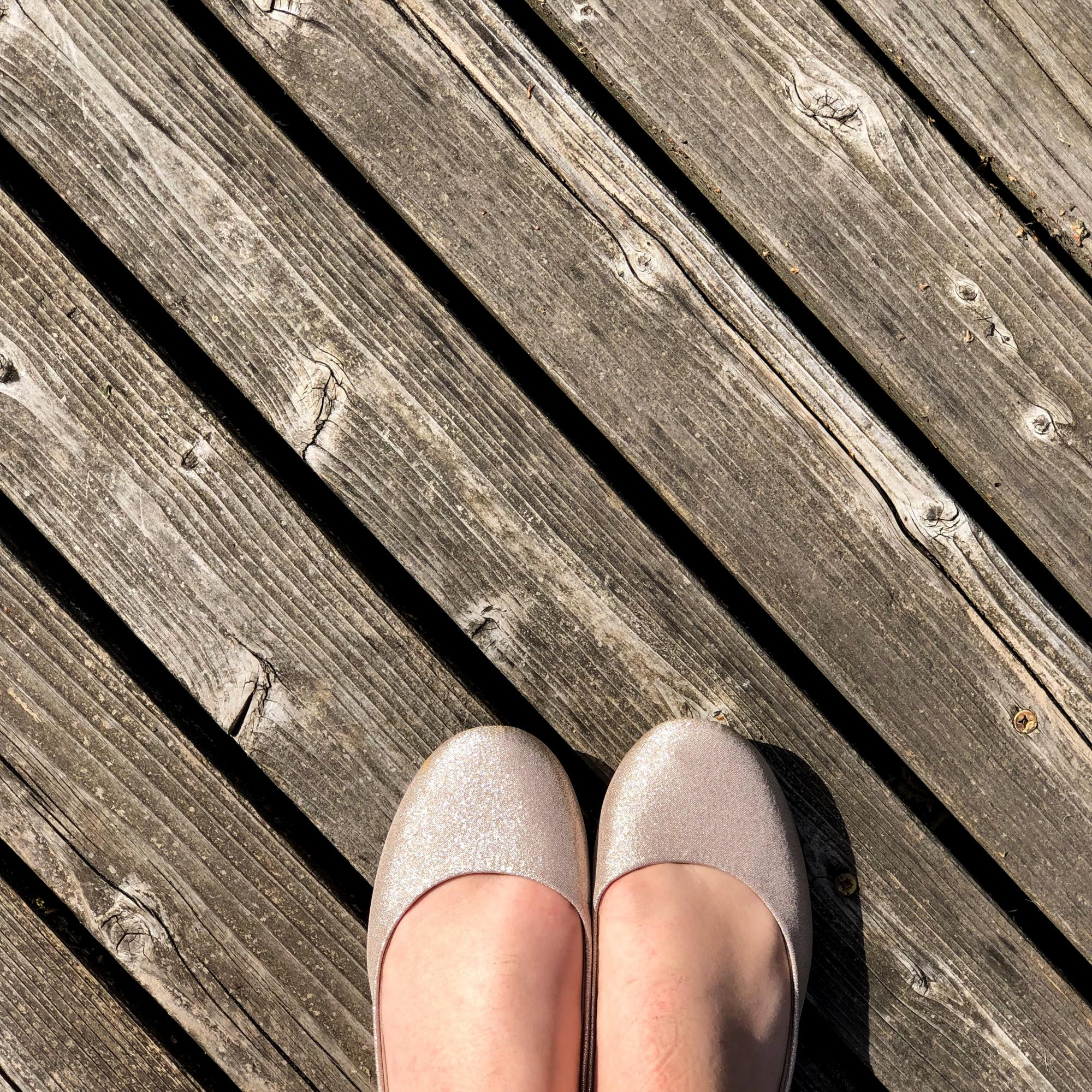 Ballet Flats on old wood deck
