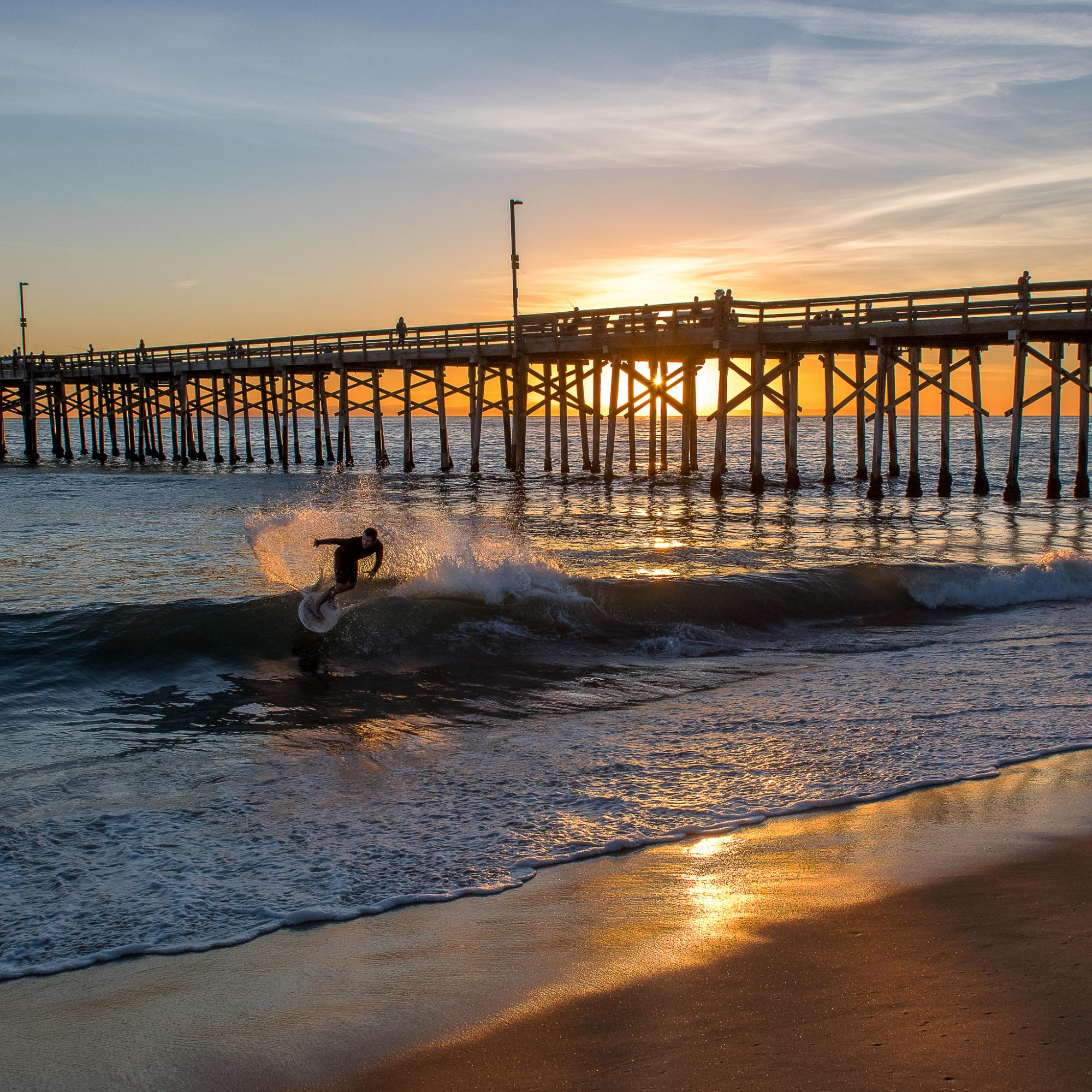 Balboa Pier sunset with skim boarder