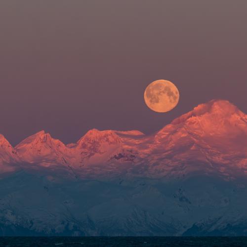 Super Moon setting in Alaska by Alaskan Thru the Lens