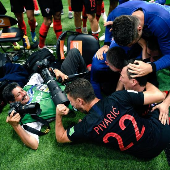 Photographer Gets a Little Too Close to World Cup Action, Takes Photos From Bottom of Dogpile