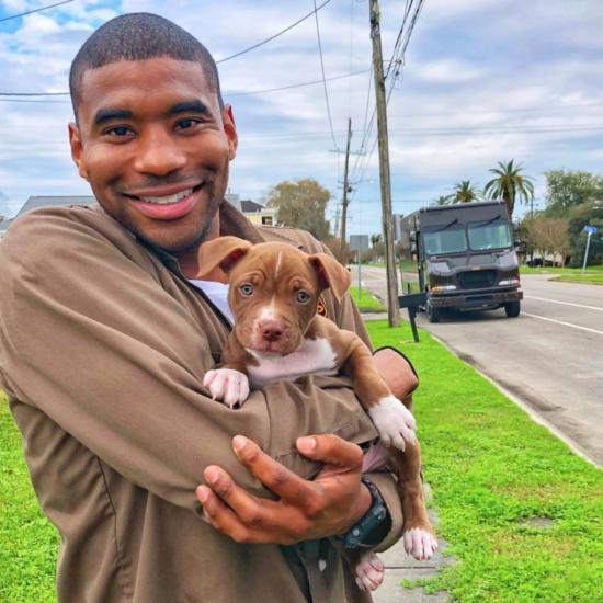 The UPS Worker Who Takes Photos With Each Pup on his Daily Route