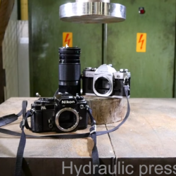 Watch a Hydraulic Press Absolutely Destroy Two Old Cameras and a Lens